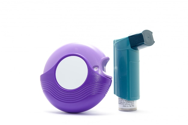 Purple and blue asthma inhalers on white background