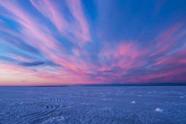 Purple blue sunset or sunrise in winter over the river