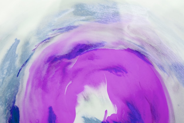 Purple and blue watercolor art over white canvas