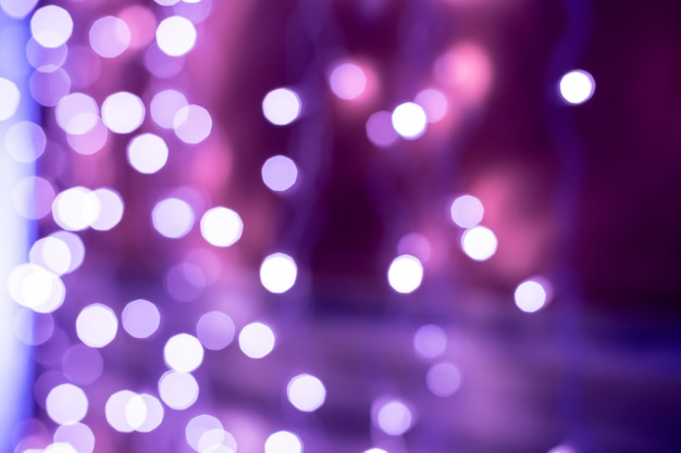 Purple bokeh blurred lights background