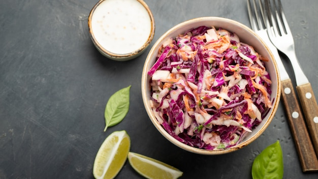 Purple cabbage and carrot salad with mayonnaise.