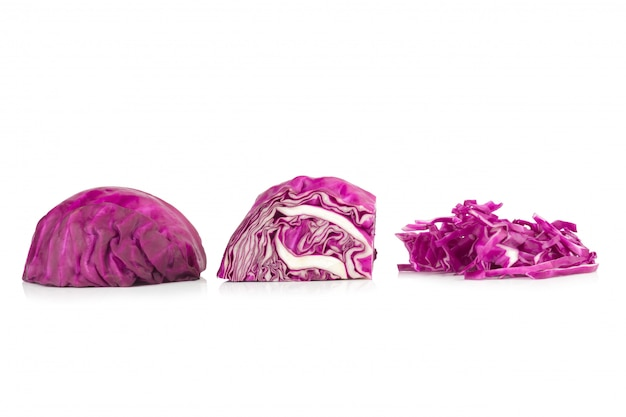 Purple cabbage half and slice isolated on white background