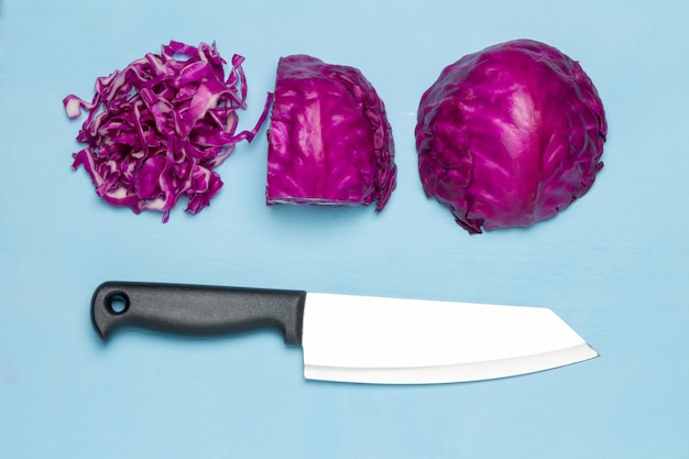 Purple cabbage half and slice. knife. isolated on white background