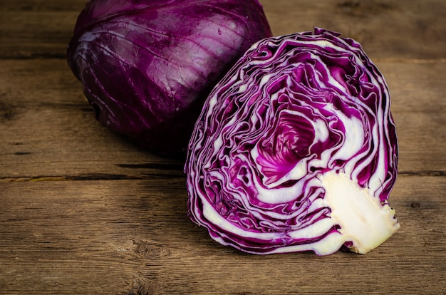 Purple cabbage or red kraut on wooden rustic background. close up