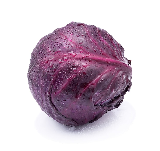 Purple cabbage with water drops isolated on white background.