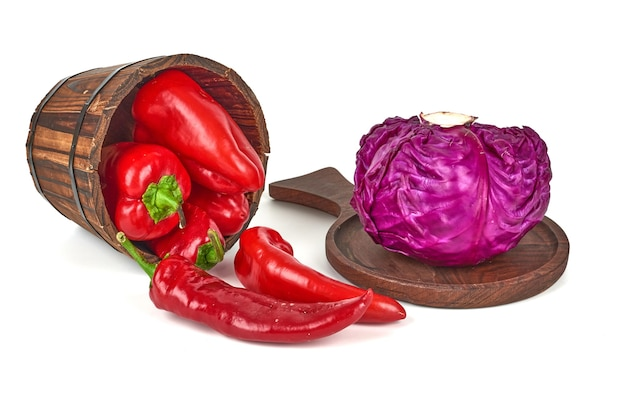 Purple cabbage on a wooden platter and chilies out of a bucket.