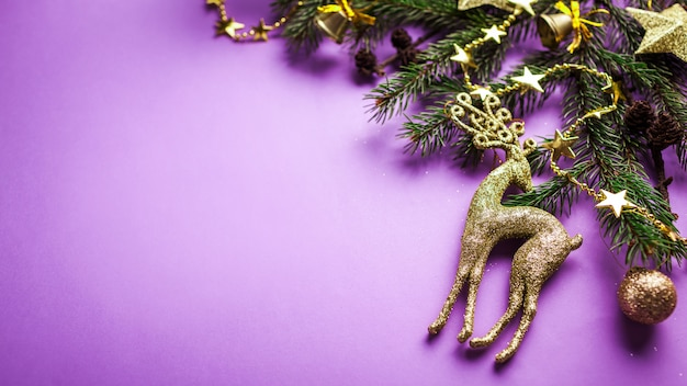 Purple christmas and new year background with decorated fir tree and toys. space. banner