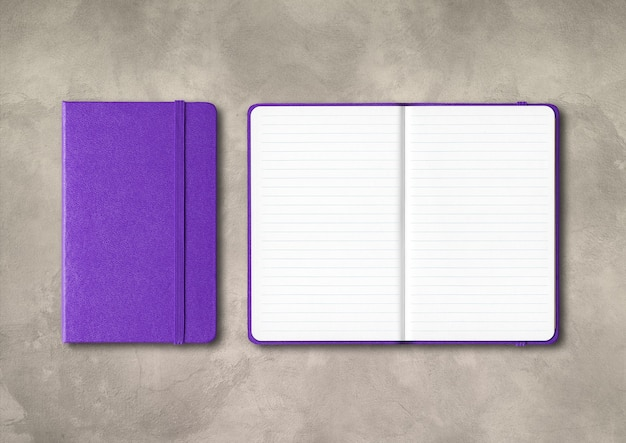 Purple closed and open lined notebooks mockup isolated on concrete background