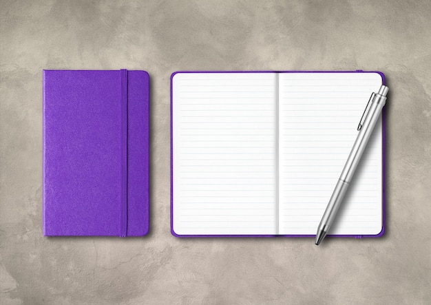 Purple closed and open lined notebooks with a pen . mockup isolated on concrete background