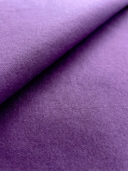紫色のキャンバステクスチャ折り畳まれた生地の背景