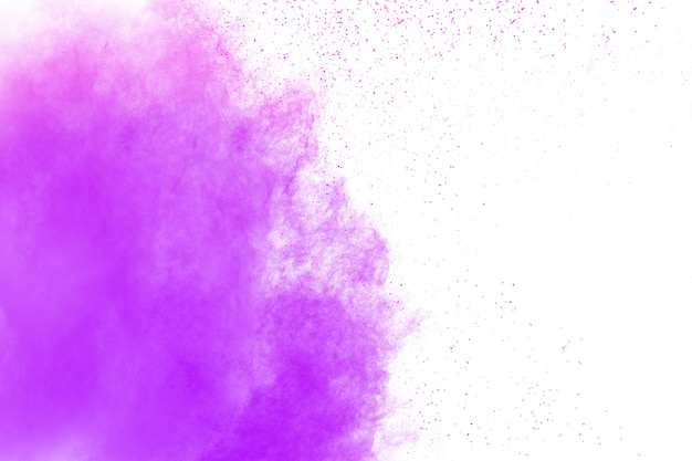Purple color powder explosion cloud on white background.