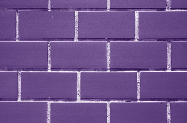 Purple colored brick wall for background, texture
