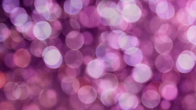 Фиолетовый цвет расфокусированным боке огни фон - горизонтальные обои, плакат. стильный, праздничный и элегантный снимок. модные цвета. освещение, свет, эффекты блеска. праздничное украшение.