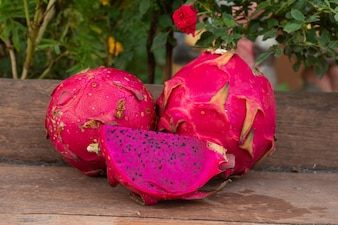 Purple dragon fruit on table wood on nature background