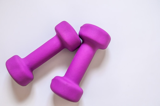 Purple dumbbells, fitness concept isolated on white background, fitness concept isolated on white background, sport, body building. concept healthy lifestyle, sport and diet. sport equipment. copy space
