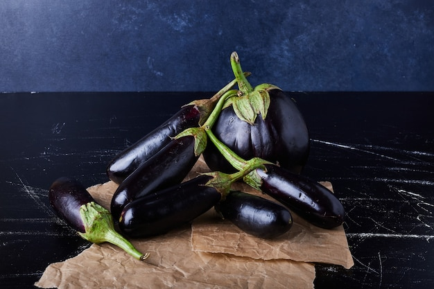 Purple eggplants on black