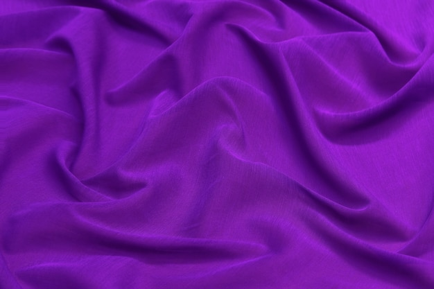 Purple fabric background and texture, crumpled of violet satin for abstract and design