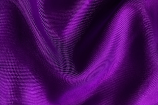 Purple fabric cloth texture for background and design art work, beautiful crumpled pattern of silk or linen.