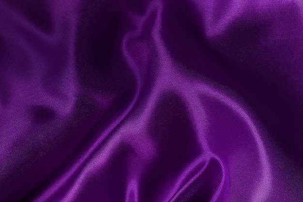 Purple fabric cloth texture for and design art work, beautiful crumpled pattern of silk or linen.
