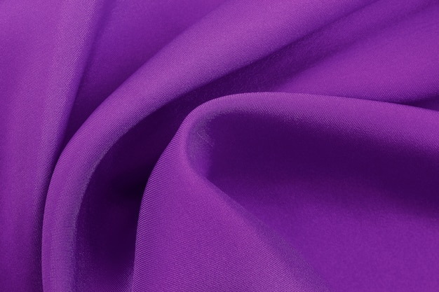 Purple fabric texture for background and design, beautiful pattern of silk or linen.