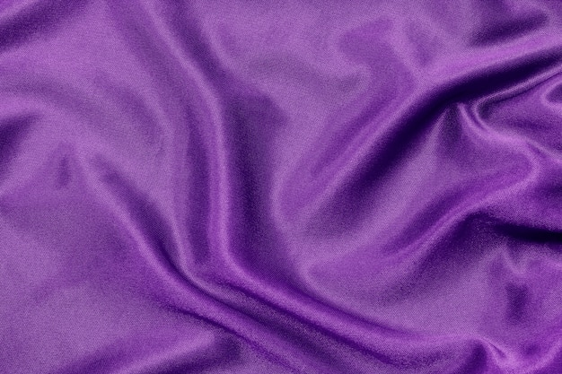 Purple fabric texture for background and design, beautiful silk or linen.