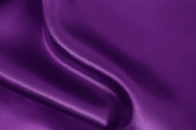 Purple fabric texture, crumpled pattern of silk or linen.