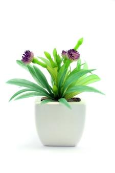 Purple fake flowers in the vase
