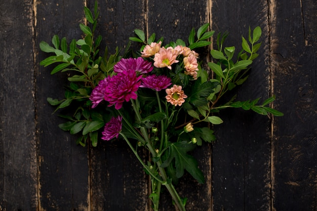 A purple flower bouquet on wood