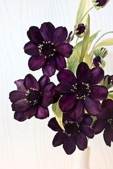 Purple flowers of marigold made of velvet.