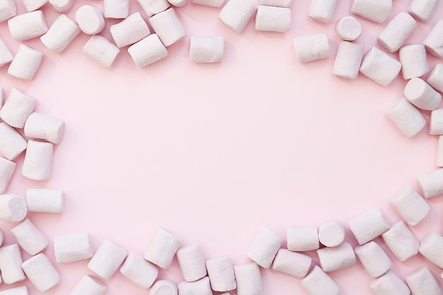 Purple frame background made of marshmallows