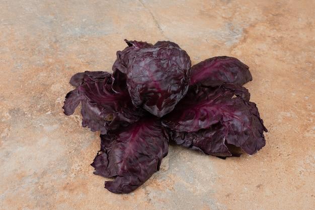 Purple fresh cabbage on marble.
