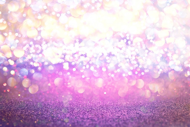 Purple glitter lights texture bokeh abstract background. defocused