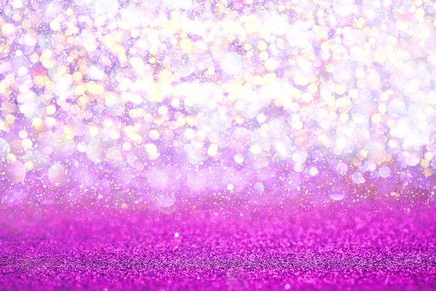 Purple glitter lights texture bokeh abstract background. defocused