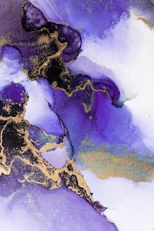 Purple gold abstract background of marble liquid ink art painting on paper .