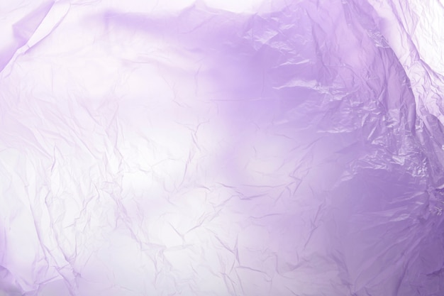 Purple gradient plastic garbage bag material as a background