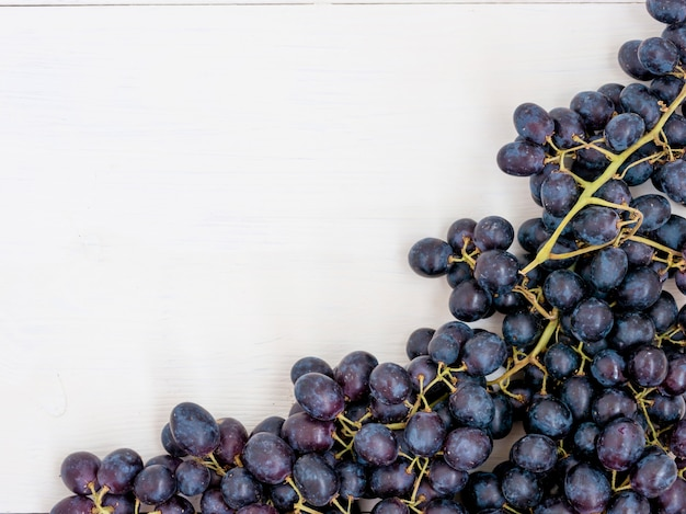 Purple grapes on wooden table