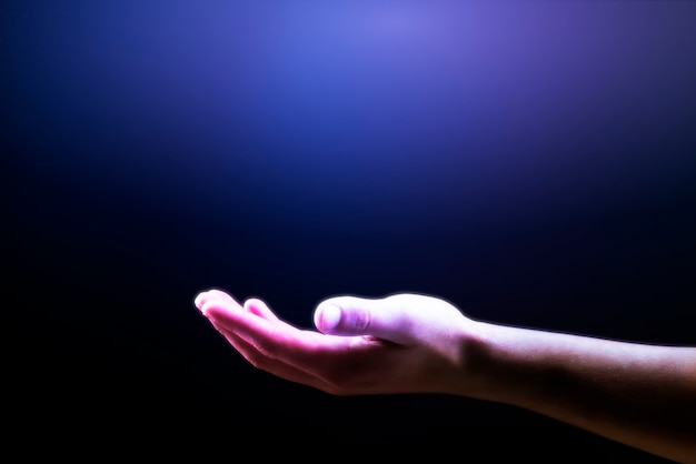 Purple hand background showing invisible object gesture