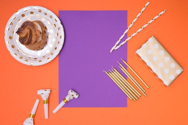 Purple invitation with birthday supplies