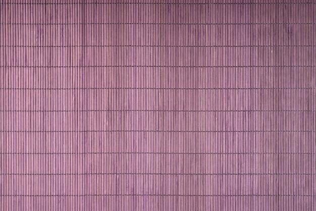 紫の日本の竹寿司マットの背景