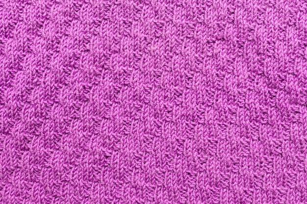 보라색 니트 뜨개질 패턴, 보라색 배경입니다.