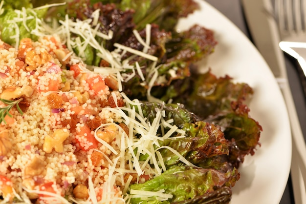 Purple lettuce salad with quinoa and tomato