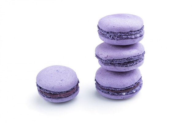 Purple macarons or macaroons cakes isolated on white background.