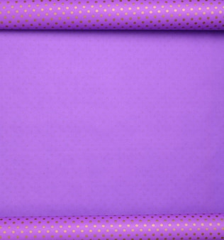 Purple paper bundle in a golden dot deployed, wrapping paper, copy space