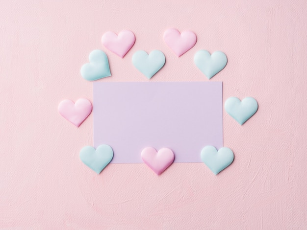 Purple pastel card and hearts on pink textured
