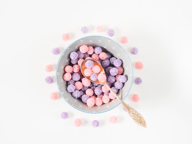 Purple and pink candies in bowl
