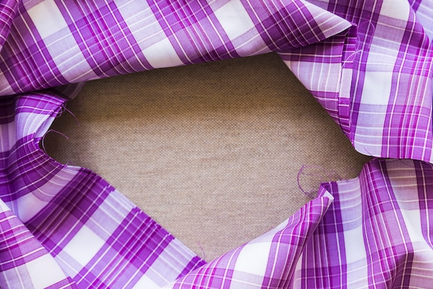 Purple plaid pattern fabric material forming frame