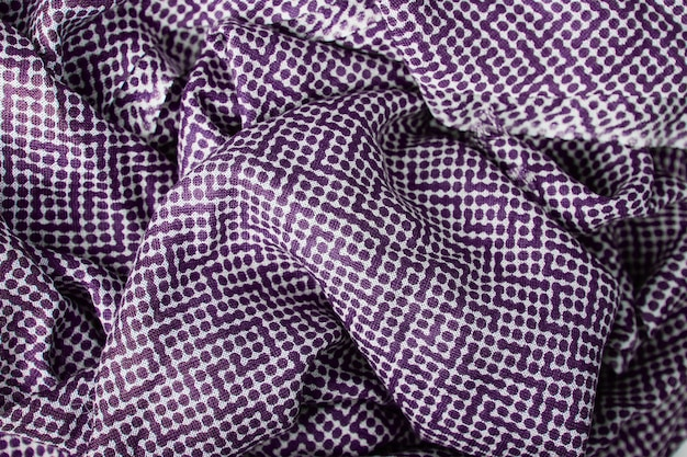 Purple polka dots fabric texture background