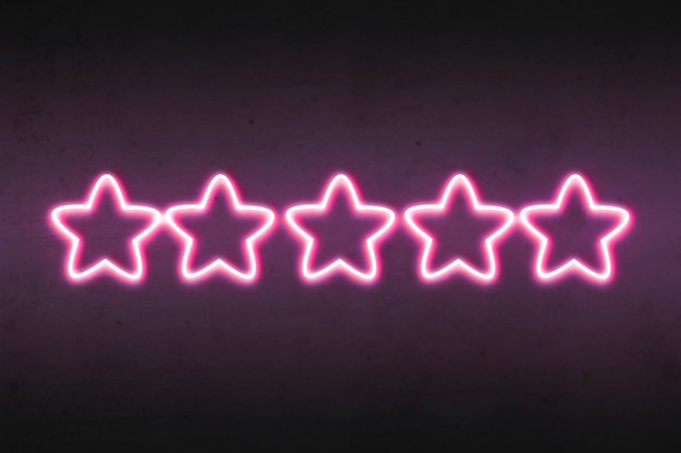 Purple rating stars on dark wall glow with bright light.