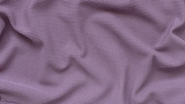 Purple ribbed corduroy texture background with waves on the surface. banner
