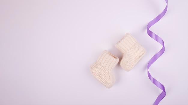 Purple ribbon and socks copy space